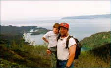 hiking above halibut cove alaska with homer in the background